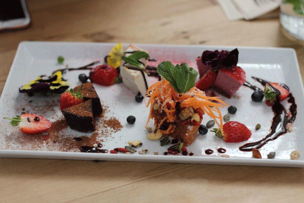 colourful raw vegan dessert platter stylishly decorated